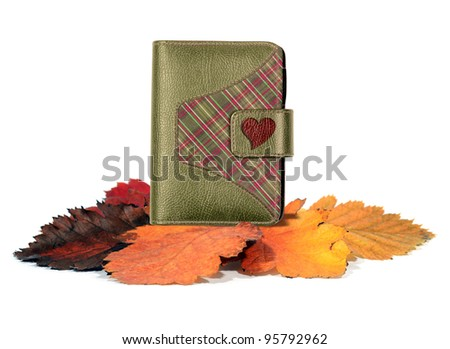 Love diary on autumn leaves
