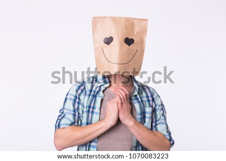 Love, emotion and relationship concept - Man with cardboard box on his head with enamored face. #1070083223