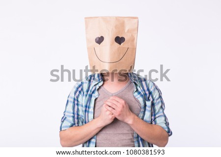 Love, emotion and relationship concept - Man with cardboard box on his head with enamored face. #1080381593
