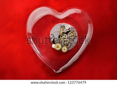 Love gear. Gear wheels inside glass heart with red background