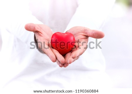 Love & healthy concept; red heart in hand, take care with love. #1190360884