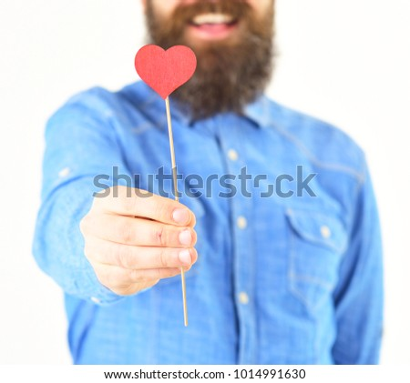 Love heart concept. Man in stylish shirt holds little red love heart on stick. #1014991630