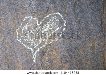 love heart drawn in chalk on a stone #1104418268