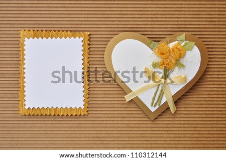 Love heart greeting or invitation card with blank paper emty for your text. Handmade paper cutout craft.