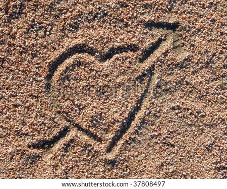 stock photo : Love heart icon in the sand