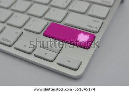 Love heart icon on modern computer keyboard button, Online dating concept