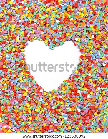 love, heart in rainbow confetti background, paper texture closeup - stock photo