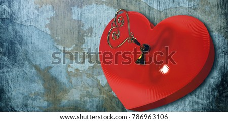 Love heart lock against rusty weathered wall