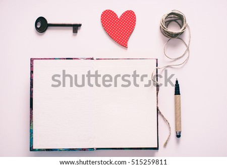 love heart on notebook with pen