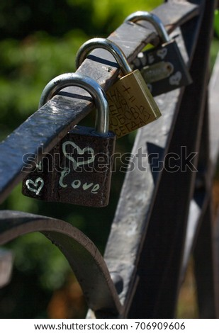 Love heart symbol. Bunch lock. Chain with many metal lockers #706909606