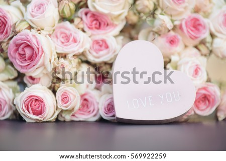 Love heart with I love you text, and bright pink roses background #569922259