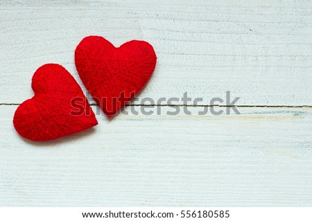 Love hearts on wooden texture background. Valentines day card concept. Original knitted heart. #556180585
