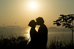 Love in sunset in the waters of the north coast of São Paulo state, Brazil/Sunset and love/Sunset landscape