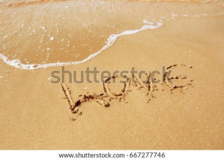 Love inscribed in the sand of a beach #667277746