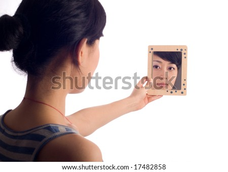 Love lady looking at mirror with wooden boarder - stock photo