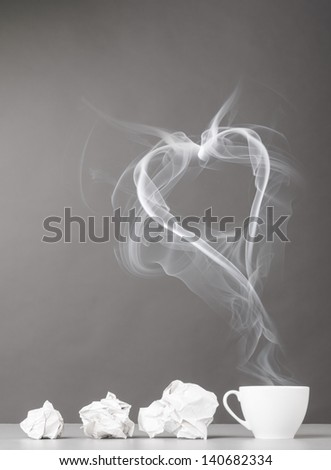 love letter. crumpled wads and heart silhouette on gray