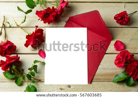 love letter valentine  rose and in envelope on wooden background, decoration for Valentines Day, copy space for text #567603685