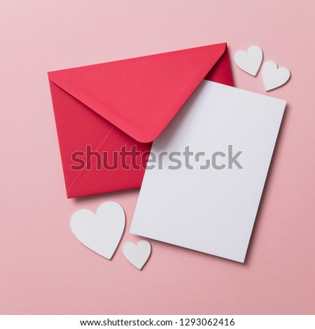 Love letter. white card with red paper envelope mock up #1293062416