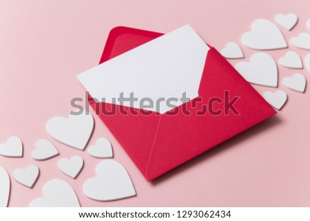 Love letter. white card with red paper envelope mock up #1293062434
