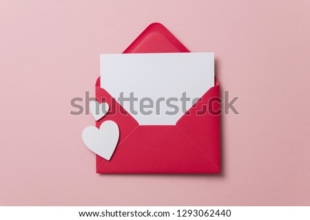 Photo of Love letter. white card with red paper envelope mock up