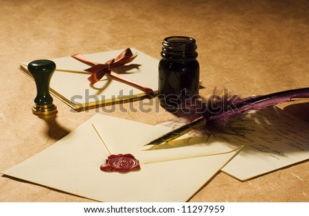 Love letters with a quill, an inkwell & a stamp on a rustic paper.
