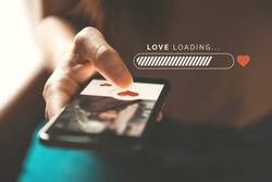 Love loading progress, Finger of woman pushing heart icon on screen in mobile smartphone application. Online dating app, valentine's day concept. Mockup website.