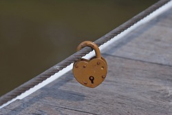 Love Lock a modern symbol of love and marriage attached to a bridge