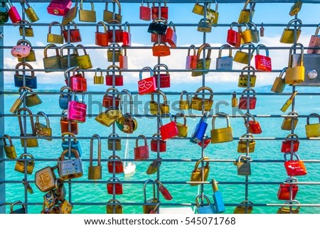 Love locks hanging on a lookout tower in friedrichshafen, germany.\r