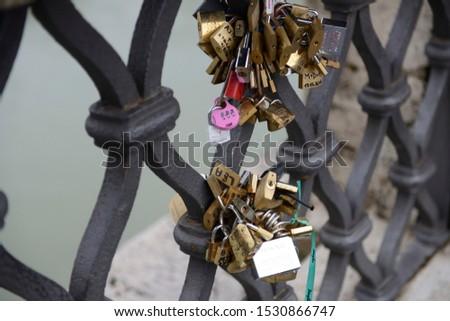 love locks hooked to the Sant'angelo bridge in Rome #1530866747