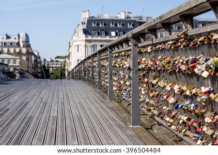 Love locks on Pont de Arts bridge in Paris with low view point