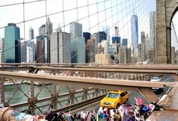 Love locks on the Brooklyn Bridge, New York, with the Manhattan Skyline in the background.