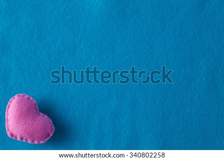 Love message concept. Soft felted heart with copy space