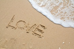 love message written in sand
