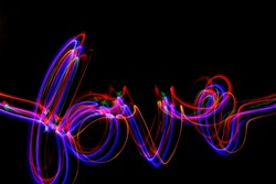Love, multi-coloured light painting photography, on a black background