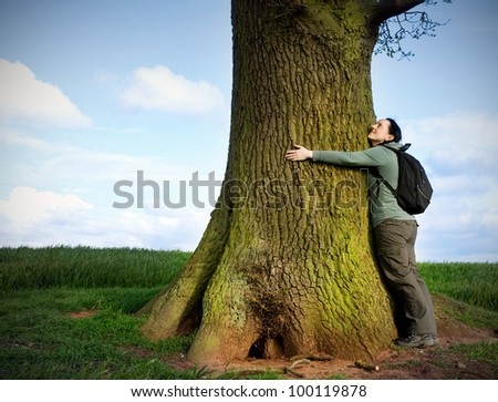 love nature, woman hugging huge tree trunk