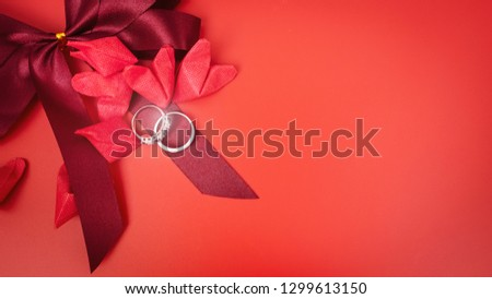 love object in valentine's day concept from paper heart and wedding ring decorate in red background