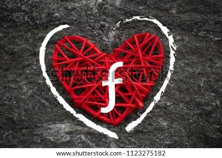 Love of money. Dutch Guilder, Aruban florin symbol on a red heart. Love theme #1123275182