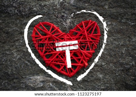 Love of money. Kazakhstan tenge symbol on a red heart. Love theme #1123275197
