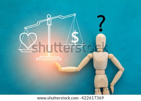 love or money decision concept wooden figure on color background
