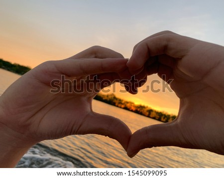 Love over the sunset over the lake