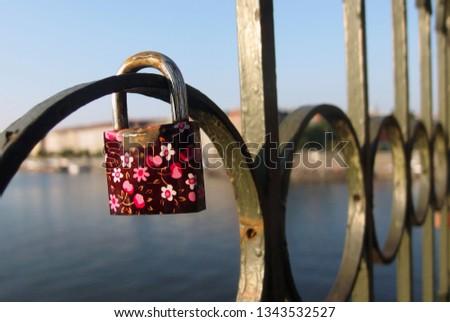 Love Padlock. Love padlock or love lock on the railing of a railway bridge in Prague. Romance. Friends, friendship. #1343532527