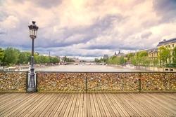 Love padlocks on Pont des Arts bridge, Seine river in Paris. France, Europe.