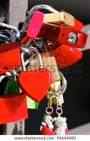 Love Padlocks or Love Locks, a modern symbol of love and marriage, attached to a bridge.