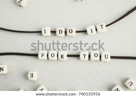 Love phrase.  A series of minimalistic conceptual compositions of beads on gray background. Words, phrases and expressions. Horizontal #740135956