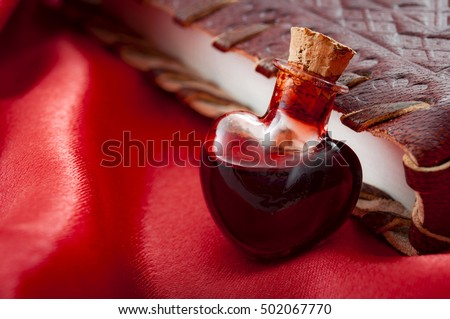 Love potion leaning on a book of magic spells for Valentine's day Stock foto ©