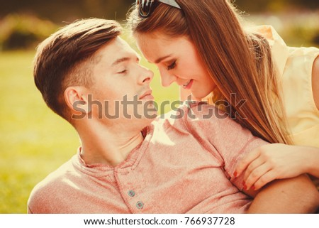 Love romance relationship dating relax concept. Affectionate couple on grass. Young enamoured girl and boy show affection in park.  #766937728