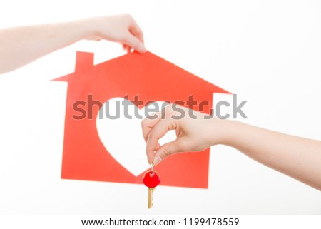 Love romance trade relationship concept. Two people exchanging symbols. Hands holding house symbol giving taking heart key. #1199478559
