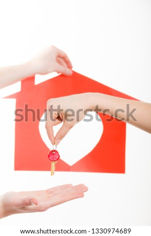 Love romance trade relationship concept. Two people exchanging symbols. Hands holding house symbol giving taking heart key. #1330974689