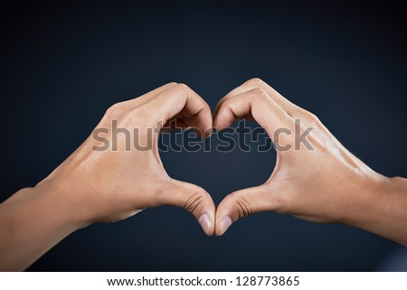 love shape hand by Handsome man #128773865