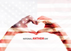 Love shape hand on usa flag means that National Anthem Day. National Anthem Day falls on March 3 annually commemorating the signing of the law.